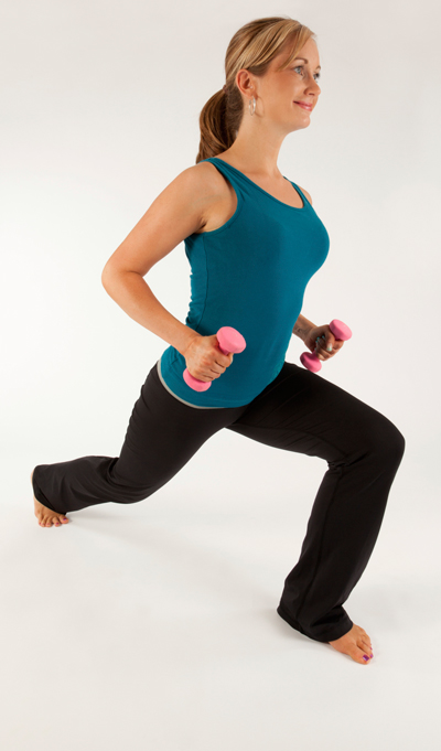 A fit woman exercising, carrying hand weight