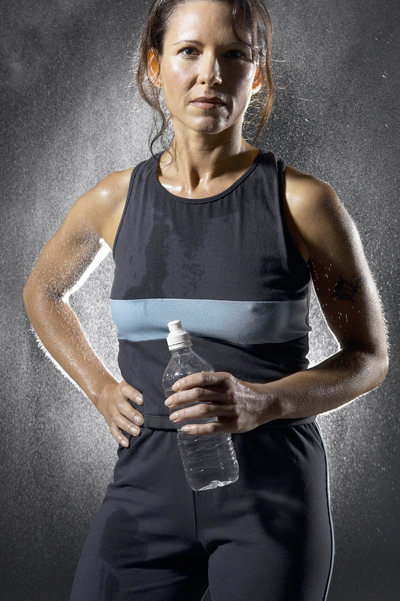 Sweaty woman drinking water