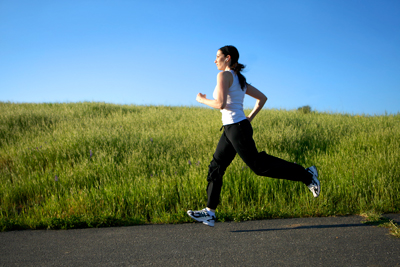 Mid adult woman running